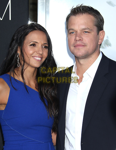 Luciana Barroso, Matt Damon<br /> &quot;Elysium&quot; Los Angeles Premiere held at the Regency Village Theatre, Westwood, California, UK,<br /> 7th August 2013.<br /> portrait headshot smiling  blue navy suit white shirt dress married couple husband wife <br /> CAP/ADM/RE<br /> &copy;Russ Elliot/AdMedia/Capital Pictures