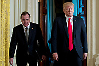 U.S. President Donald Trump, right, and Stefan Lofven, Sweden's prime minister, arrive to a news conference in the East Room of the White House in Washington, D.C., U.S., on Tuesday, March 6, 2018. Trump and Lofven are looking to focus on trade and investment between the two countries and ways to achieve shared defense goals.<br /> CAP/MPI/RS<br /> &copy;RS/MPI/Capital Pictures