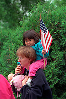 Mom and Asian daughter age 34 and 2 at Vietnam Wall on Memorial Day. St Paul Minnesota USA