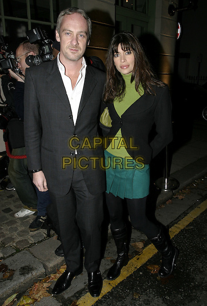 ANTON BILTON & LISA B.At Kelly Hoppen Book Launch party, Cheyne Walk Brasserie, Cheyne Walk, London, 10th November 2004..full length husband wife married green top mini short skirt knee high boots black tights jacket bag.Ref: AH.www.capitalpictures.com.sales@capitalpictures.com.©Capital Pictures.