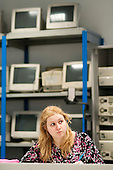 Student in a Computer Studies class, Kingston College.  Behind her are obsolete monitors used to demonstrate older technologies.