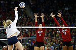 KANSAS CITY, KS - DECEMBER 14: Kelly Hunter #3 and Briana Holman #13 of the University of Nebraska jump for a block against Ali Frantti #5 of Penn State University during the Division I Women's Volleyball Semifinals held at Sprint Center on December 14, 2017 in Kansas City, Missouri. (Photo by Tim Nwachukwu/NCAA Photos via Getty Images)