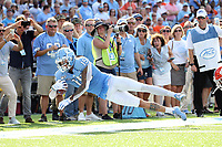 CHAPEL HILL, NC - SEPTEMBER 28: Beau Corrales #15 of the University of North Carolina leaps forward for extra yards on a pass play during a game between Clemson University and University of North Carolina at Kenan Memorial Stadium on September 28, 2019 in Chapel Hill, North Carolina.