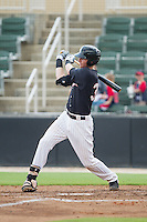 Danny Hayes (32) of the Kannapolis Intimidators follows through on his swing against the Lakewood BlueClaws at CMC-NorthEast Stadium on July 20, 2014 in Kannapolis, North Carolina.  The Intimidators defeated the BlueClaws 7-6. (Brian Westerholt/Four Seam Images)