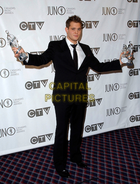 MICHAEL BUBLE.The 35th Annual JUNO Awards held at the Halifax Metro Centre, Halifax, Nova Scotia, Canada. The JUNO Awards known as Canada's Music Awards are presented to Canada's best. .April 2nd, 2006.Photo: George Shepherd/AdMedia .Ref: GS/ADM.full length black suit awards trophies.www.capitalpictures.com.sales@capitalpictures.com.© Capital Pictures.