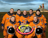 Houston, TX - July 26, 2007 -- These seven astronauts take a break from training to pose for the STS-123 crew portrait. From the right (front row) are astronauts Dominic L. Gorie, commander; and Gregory H. Johnson, pilot. From the left (back row) are astronauts Richard M. Linnehan, Robert L. Behnken, Garrett E. Reisman, Michael J. Foreman and Japan Aerospace Exploration Agency's (JAXA) Takao Doi, all mission specialists. Reisman is scheduled to join Expedition 16 as flight engineer after launching to the International Space Station on mission STS-123. The crewmembers are attired in training versions of their shuttle launch and entry suits.  STS-123, flying aboard the Space Shuttle Endeavour, is scheduled for launch at 2:28 a.m. EDT Tuesday, March 11, 2008.  Its mission is to deliver the first pressurized component of the Japanese Kibo (Hope) Laboratory and a Canadian robotic device called Dextre utilizing 5 spacewalks.  Its 16-day flight is the longest shuttle mission to date..Credit: NASA via CNP