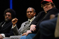 January 12, 2012  (Washington, DC)  Dr. Cornell West (left), Radio and television talk show host Tavis Smiley (center), and filmmaker Michael Moore listen to a panelist during a discussion on restoring America's prosperity at the George Washington University Lisner Auditorium in Washington.  (Photo by Don Baxter/Media Images International)