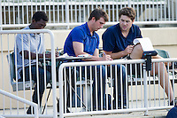 (L-R) Robinson Leyer (left) and Thad Lowry (center) of the Kannapolis Intimidators and Lucas Giolito (right) of the Hagerstown Suns chart a variety of pitch data during the South Atlantic League game at CMC-Northeast Stadium on June 1, 2014 in Kannapolis, North Carolina.  The Intimidators defeated the Intimidators 11-5 in game two of a double-header.  (Brian Westerholt/Four Seam Images)