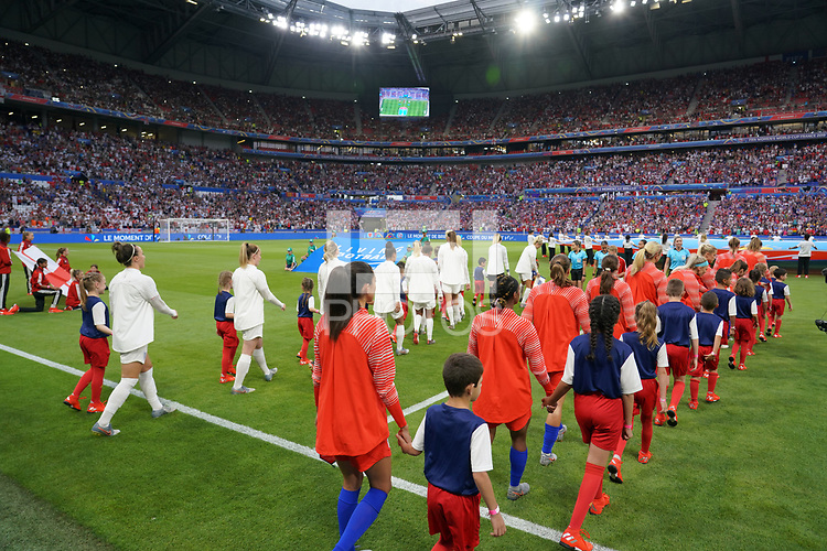 DECINES-CHARPIEU, FRANCE - JULY 02: USWNT starting eleven walking out vs England during a 2019 FIFA Women's World Cup France Semi-Final match between England and the United States at Groupama Stadium on July 02, 2019 in Decines-Charpieu, France.