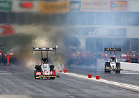 Apr 26, 2014; Baytown, TX, USA; NHRA top fuel driver Doug Kalitta (left) races alongside a slowing Khalid Albalooshi during qualifying for the Spring Nationals at Royal Purple Raceway. Mandatory Credit: Mark J. Rebilas-
