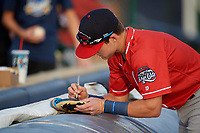 New Hampshire Fisher Cats Logan Warmoth (5) signs autographs before an Eastern League game against the Trenton Thunder on August 20, 2019 at Arm & Hammer Park in Trenton, New Jersey.  New Hampshire defeated Trenton 7-2.  (Mike Janes/Four Seam Images)
