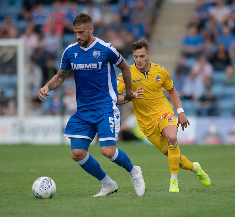 Gillingham's skipper Max Ehmer (left) under pressure from Bolton Wanderers' Dennis Politic (right) <br /> <br /> Photographer David Horton/CameraSport<br /> <br /> The EFL Sky Bet League One - Gillingham v Bolton Wanderers - Saturday 31st August 2019 - Priestfield Stadium - Gillingham<br /> <br /> World Copyright © 2019 CameraSport. All rights reserved. 43 Linden Ave. Countesthorpe. Leicester. England. LE8 5PG - Tel: +44 (0) 116 277 4147 - admin@camerasport.com - www.camerasport.com