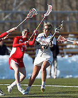 Boston College attacker Covie Stanwick (8) on the attack as Boston University midfielder Jill Horka (1) defends..Boston College (white) defeated Boston University (red), 12-9, on the Newton Campus Lacrosse Field at Boston College, on March 20, 2013.