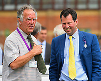 Trainer Charles Hills with a member of the racing press in the winners enclosure after winning The Dee Wilks Against The Odds Confined Novice Stakes (Div 2) during Afternoon Racing at Salisbury Racecourse on 12th June 2018