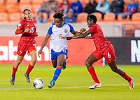 HOUSTON, TX - FEBRUARY 3: Melchie Dumonay #6 of Haiti takes a shot on goal past Maria Murillo #6 of Panama during a game between Panama and Haiti at BBVA Stadium on February 3, 2020 in Houston, Texas.