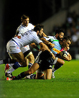 Nick Easter of Harlequins is tackled by Thomas Combezou and Christopher Tuatara of Castres Olympique during the European Rugby Champions Cup  Round 1 match between Harlequins and Castres Olympique at the Twickenham Stoop on Friday 17th October 2014 (Photo by Rob Munro)