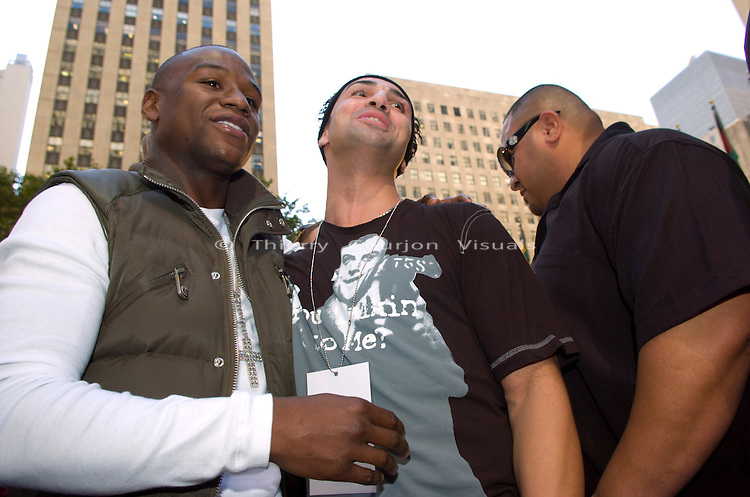 "09.19.2007, New York N.Y.: (l-r) Floyd Mayweather and Paulie Malignaggi taunt Ricky Hatton at the Rockefeller Center, during the ""Mayweather vs Hatton"" press conference annoucing their December 8, 2007 World Championship fight  in Las Vegas."