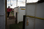 A visiting team's player arriving at Lye Meadow before Alvechurch hosted Highgate United in a Midland Football League premier division match. Originally founded in 1929 and reformed in 1996 after going bust, the club has plans to move from their current historic ground to a new purpose-built stadium in time for the 2017-18 season. Alvechurch won this particular match by 3-0, watched by 178 spectators, taking them back to the top of the league.