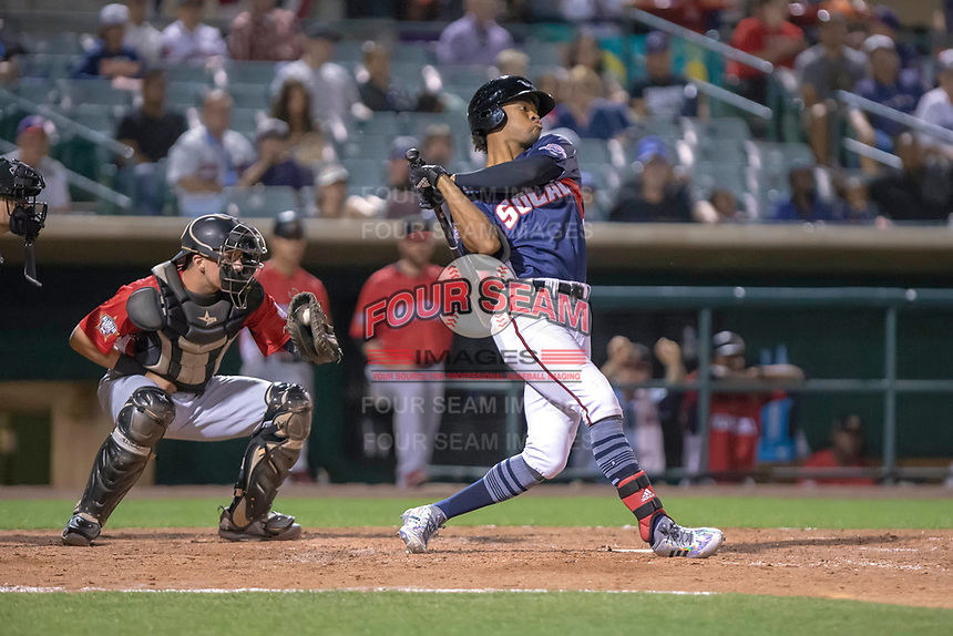 Buddy Reed (23) of the Lake Elsinore Storm follows through on his swing against the North Division during the 2018 California League All-Star Game at The Hangar on June 19, 2018 in Lancaster, California. The North All-Stars defeated the South All-Stars 8-1.  (Donn Parris/Four Seam Images)