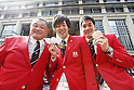 (L-R)  Yasuhiro Yamashita, Masato Sakai, Yuki Kobori (JPN), OCTOBER 7, 2016 : Japanese medalists of Rio 2016 Olympic and Paralympic Games wave to spectators during a parade from Ginza to Nihonbashi, Tokyo, Japan. (Photo by AFLO SPORT)