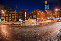 Giant mounds of snow in the process of getting indescribably filthy are piled up in the New York neighborhood of Chelsea in the aftermath of Winter Storm Jonas on Sunday, January 24, 2016. The blizzard dumped 26.8 inches onto Central Park making it the second-highest amount since records started in 1869.  (© Richard B. Levine)