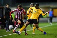 Lincoln City's Kellan Gordon vies for possession with Wolverhampton Wanderers U21's Sadou Diallo<br /> <br /> Photographer Chris Vaughan/CameraSport<br /> <br /> The EFL Checkatrade Trophy Northern Group H - Lincoln City v Wolverhampton Wanderers U21 - Tuesday 6th November 2018 - Sincil Bank - Lincoln<br />  <br /> World Copyright © 2018 CameraSport. All rights reserved. 43 Linden Ave. Countesthorpe. Leicester. England. LE8 5PG - Tel: +44 (0) 116 277 4147 - admin@camerasport.com - www.camerasport.com