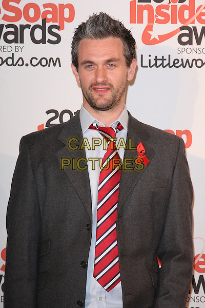 GUEST .Attending the Inside Soap Awards 2010 held at Shaka Zulu, Camden, London, England, UK, September 27th 2010.half length red tie grey gray jacket suit beard facial hair striped .CAP/ROS.©Steve Ross/Capital Pictures