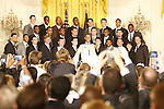 President Barack Obama and the University of Kentucky mens basketball team pose for a picture during the UK National Championship Celebration in the East Room of the White House, in Washington D.C., May 4, 2012. Obama is holding Darius Miller's Jersey, presented to him as a gift. Photo by Brandon Goodwin | Staff