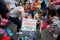 Roma 20 Giugno 2015<br /> Family Day &ldquo;Difendiamo i nostri figli&raquo;, manifestazione nazionale organizzata in piazza San Giovanni, &quot;per riaffermare il diritto di mamma e pap&agrave; a educare i figli e fermare la colonizzazione ideologica della teoria Gender nelle scuole e nel Parlamento&quot;. Sul cartello si legge:  non insegnatemi la masturbazione sono felice cos&igrave;<br /> Rome June 20, 2015<br /> Family Day &quot;We defend our children,&quot; national demonstration organized in Piazza San Giovanni, &quot;to reaffirm the right of mom and dad to educate their children and stop the colonization of ideological of the theory Gender in schools and in the Parliament&quot;.<br /> The sign reads: Do not teach me masturbation are  happy so.