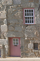 old house stone facade with small door near the port porto portugal