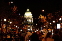 People walk up State Street in front of the State Capitol during Freakfest 2015 on State Street in Madison, Wisconsin