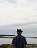 A man looks out on the Atlantic Ocean in Blue Rocks, Nova Scotia. Photo by Kevin J. Miyazaki/Redux