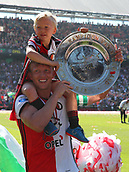 May 14th 2017, Rotterdam, Netherlands;  Feyenoord Rotterdams Dirk Kuyt celebrates with his son after the Dutch Eredivisie match between Feyenoord Rotterdam and Heracles Almelo in Rotterdam, the Netherlands, May 14, 2017.  This was Kuyt last game for his club before retiring from the game.