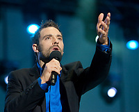 French-Canadian artist Guillaume Lemay-Thivierge performs during the St-Jean-Baptist show on the Plains of Abraham in Quebec city June 23, 2009.
