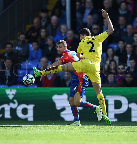 April 29th 2017, Selhurst Park, London England; EPL Premier league football, Crystal Palace versus Burnley; Matthew Lowton, Defender for Burnley controls the ball away from James McArthur, Midfielder for Crystal Palace