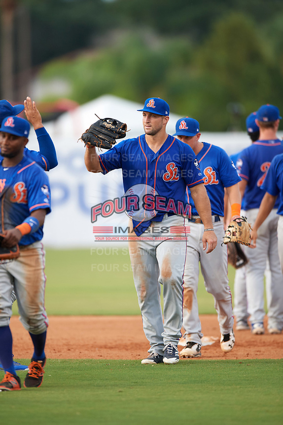 St. Lucie Mets left fielder Tim Tebow (15) high fives teammates after a game against the Florida Fire Frogs on July 23, 2017 at Osceola County Stadium in Kissimmee, Florida.  St. Lucie defeated Florida 3-2.  (Mike Janes/Four Seam Images)