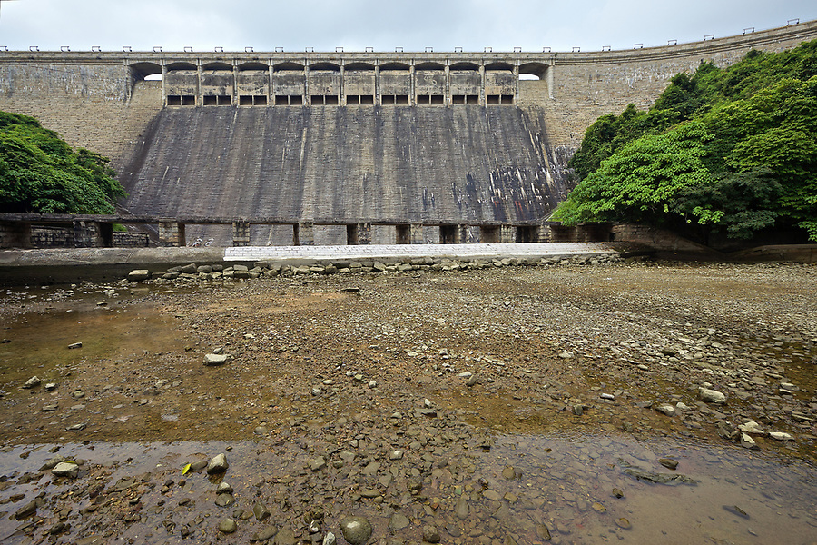 The dam wall on the Tai Tam Tuk Reservoir (1918), Tai Tam Group of Reservoirs.<br /> <br /> Twenty-one structures (together with the Bowen Road aqueduct) make up he 88th Declared Monument on Hong Kong Island.