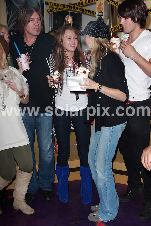 **ALL ROUND PICTURES FROM SOLARPIX.COM**.**WORLDWIDE SYNDICATION RIGHTS**.**NO PUBLICATION IN AUSTRALIA, NEW ZEALAND, DENMARK, GERMANY OR USA**.Miley Cyrus has a night out with her dad, friends and puppy while having milkshakes at Millions of Milkshakes in Hollywood. California, USA. 14th October 2008..This pic: Billy Ray Cyrus and Miley Cyrus..JOB REF: 7598 LAP (JS)      DATE: 14_10_2008.**MUST CREDIT SOLARPIX.COM OR DOUBLE FEE WILL BE CHARGED* *UNDER NO CIRCUMSTANCES IS THIS IMAGE TO BE REPRODUCED FOR ANY ONLINE EDITION WITHOUT PRIOR PERMISSION*