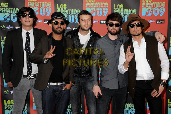 ZOE aka Zoé  - León Larregui, Sergio Acosta, Jesus Baez, Angel Mosqueda & Rodrigo Guardiola.MTV Los Premios Awards 2009 held at the Gibson Amphitheatre, Universal City, California, USA, 15th October 2009..half length band group hat sunglasses black grey gray hand gesture suit tie white beard facial hair .CAP/ADM/BP.©Byron Purvis/Admedia/Capital Pictures