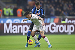 Sebastiano Esposito of Inter tussles with Fabio Pisacane of Cagliari during the Coppa Italia match at Giuseppe Meazza, Milan. Picture date: 14th January 2020. Picture credit should read: Jonathan Moscrop/Sportimage