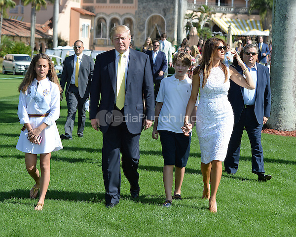 PALM BEACH FL - JANUARY 4: Donald Trump, Melania Trump and Barron Trump attend The Trump Invitational Grand Prix at Club Mar-a-Lago on January 4, 2015 in Miami, FL Florida. Credit: mpi04/MediaPunch