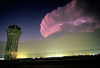 Internal lightning illuminates the sky over Robert Mueller Airport in Austin, Texas. The airport is slated to become a new, planned community with shopping malls and recreation fields. A children's hospital is already being built on the land.