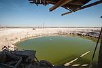 Pool in the mud at a former lake-shore resort (spa) at the southern end of the Salton Sea, Salton Sea, Calif.