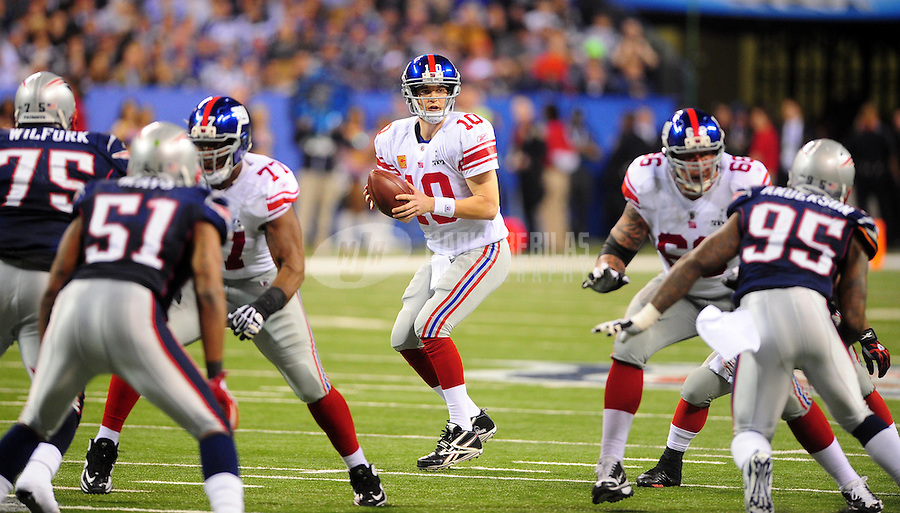 Feb 5, 2012; Indianapolis, IN, USA; New York Giants quarterback Eli Manning (10) drops back to pass during the second half of Super Bowl XLVI against the New England Patriots at Lucas Oil Stadium.  Mandatory Credit: Mark J. Rebilas-