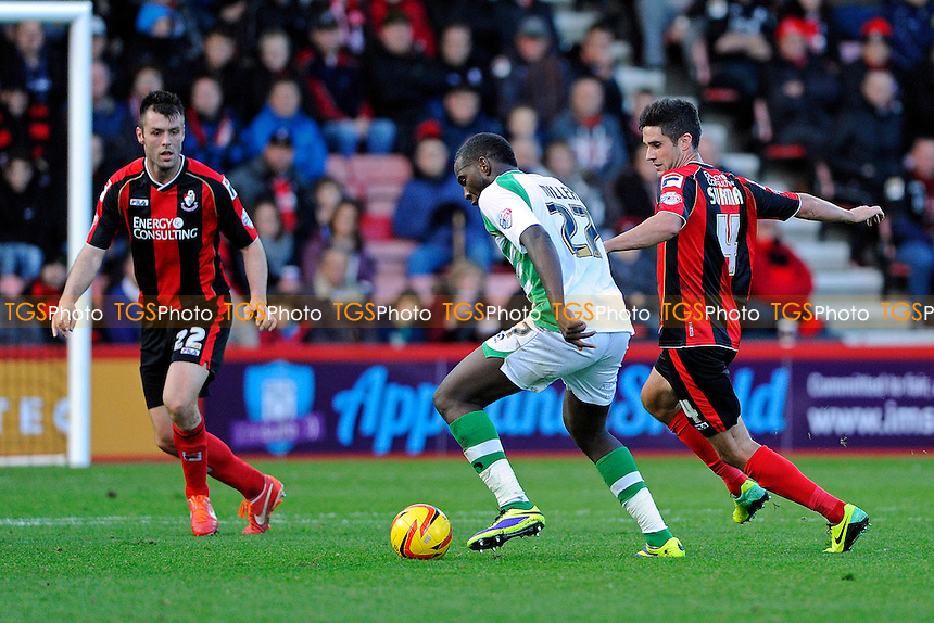 Ishmael Miller of Yeovil Town takes on Elliott Ward and Andrew Surman of AFC Bournemouth - AFC Bournemouth vs Yeovil Town - Sky Bet Championship Football at the Goldsands Stadium, Bournemouth, Dorset - 26/12/13 - MANDATORY CREDIT: Denis Murphy/TGSPHOTO - Self billing applies where appropriate - 0845 094 6026 - contact@tgsphoto.co.uk - NO UNPAID USE