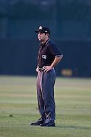 First Base Umpire Ramon Hernandez during the Dunedin Blue Jays and Daytona Cubs game at Jackie Robinson Ballpark on April 11, 2012 in Daytona Beach, Florida. (Scott Jontes / Four Seam Images)
