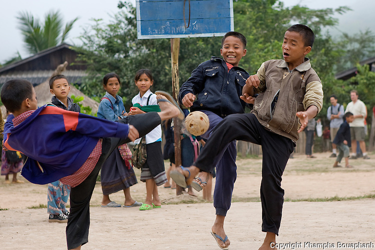 Laotian boys play a game of kator during a break at school in Luang Namtha, Laos on November 9, 2009.   (Photo by Khampha Bouaphanh)