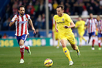 Juanfran Torres of Atletico de Madrid and Cheryshev of Villarreal during La Liga match between Atletico de Madrid and Villarreal at Vicente Calderon stadium in Madrid, Spain. December 14, 2014. (ALTERPHOTOS/Caro Marin) /NortePhoto