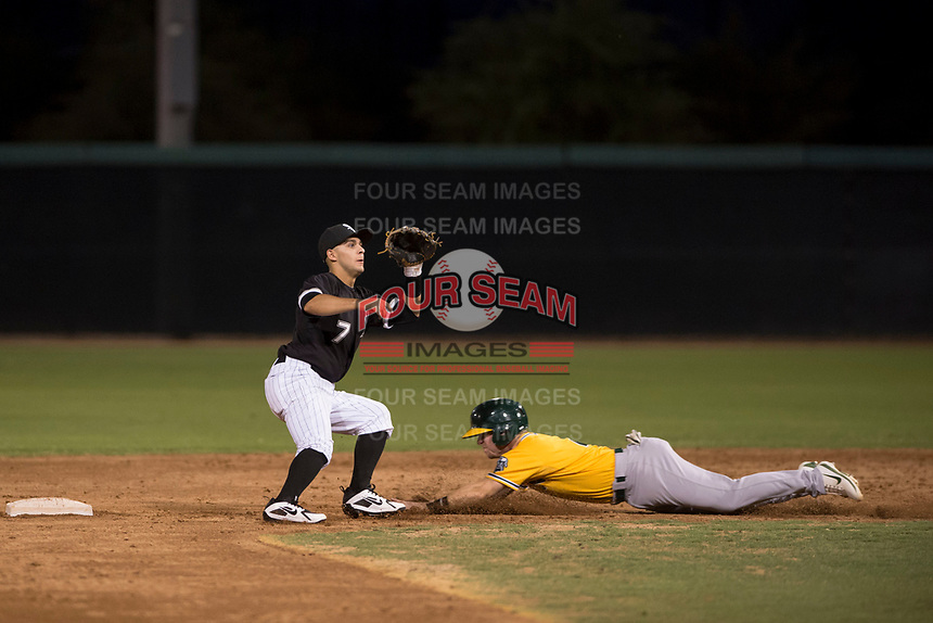 AZL White Sox second baseman Nick Madrigal (7) covers second base on a stolen base attempt by Nick Ward (4) during an Arizona League game against the AZL Athletics at Camelback Ranch on July 15, 2018 in Glendale, Arizona. The AZL White Sox defeated the AZL Athletics 2-1. (Zachary Lucy/Four Seam Images)
