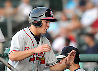 Outfielder Tony Mueller (10) of the Rome Braves, Class A affiliate of the Atlanta Braves, in a game against the Greenville Drive on July 18, 2011, at Fluor Field at the West End in Greenville, South Carolina. (Tom Priddy/Four Seam Images)